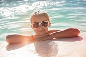 stock photo of instagram  - Beautiful little blond girl with sunglasses in outdoor pool closeup bright summer portrait colorful toned photo old style instagram filter effect - JPG