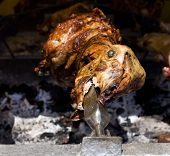 stock photo of spit-roast  - Close up of lamb spinning on the spit - JPG