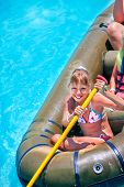 foto of inflatable slide  - Family ride rubber boat in water park - JPG