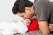 foto of forehead  - Father kissing his new born baby forehead - JPG