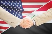picture of iraq  - Businessmen shaking hands  - JPG
