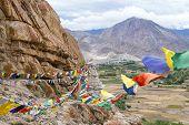 picture of buddhist  - Plenty of colorful Buddhist prayer flags on the Stupa near Takthok gompa Buddhist monastery in Ladakh Jammu  - JPG