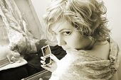 Vintage portrait of pretty girl with your things.(gems, mirror, clothes)
