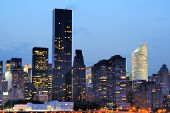 stock photo of gleaning  - Cityscape of Midtown Manhattan across the Hudson River at night - JPG