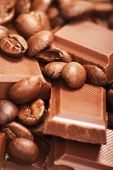 Chocolate-Coffee background: Close-up of a beans, cup, mill