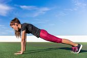 Fitness woman planking doing the bodyweight exercise for core strength training. Active girl practic poster