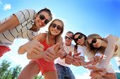 stock photo of summer fun  - Cheerful young people having fun on a beach - JPG