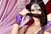 image of concubine  - Shot of an oriental woman in a traditional costume - JPG