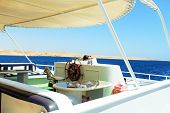 Private motor yacht under way out at sea.
