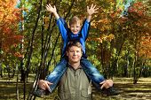 image of family love  - Happy father walking at the autumn park with his son - JPG