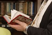picture of atonement  - Priest with a Holy Bible - JPG