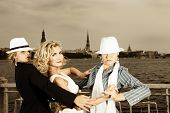 stock photo of threesome  - Threesome tango near the river - JPG