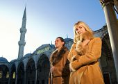 Young attractive couple in lambskin coats (Istanbul, Turkey)