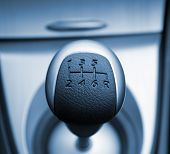 Six speed gear stick toned in blue (shallow DoF)