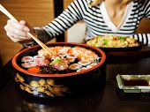 Close-up shot of a sushi plate (shallow DoF, focus on sushi)