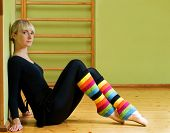 image of leg warmer  - Beautiful ballet dancer sitting on a floor and relaxing after exercise - JPG