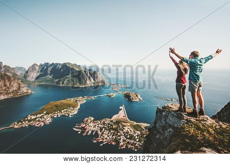 poster of Happy Couple Love And Travel Raised Hands On Cliff In Norway Man And Woman Family Travelers Lifestyl