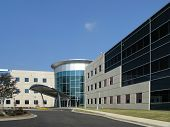 pic of commercial building  - Office Building with stone and glass exterior - JPG