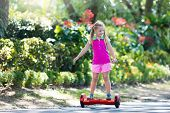 Child On Hover Board. Kids Ride Scooter. poster