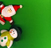 Santa Claus and snowman on the green Christmas background