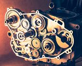 disassembled engine of motorcycle with gear cogwheels, close-up view poster