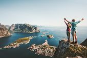 Happy Couple Love And Travel Raised Hands On Cliff In Norway Man And Woman Family Travelers Lifestyl poster