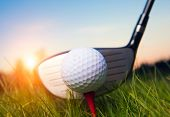 Golf club and ball in grass with sunlight. Close up at golf club and golf ball poster