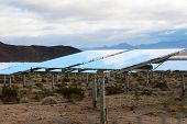 Solar Farm in the California - Nevada Desert. Solar Panels turn sunlight into electricity. Ecology.  poster