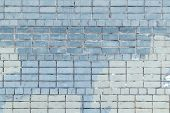 The Wall Is Made Of Bricks Of Celeste And Blue Color. Beautiful Background Of Smooth Masonry. Textur poster