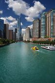View Of The Chicago Skyline And Tour Boats On The Chicago River poster