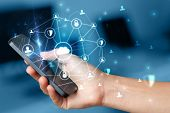 Hand using phone with centralized cloud computing system and network security concept poster