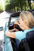 Woman in sports car