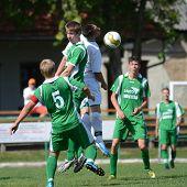 KAPOSVAR, HUNGARY - SEPTEMBER 5: Balazs Butor (green 5) in action at the Hungarian National Championship under 19 game Kaposvar (white) vs. Nagyatad (green) September 5, 2011 in Kaposvar, Hungary.
