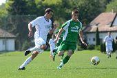 KAPOSVAR, HUNGARY - SEPTEMBER 5: Kristof Kovacs (in green) in action at the Hungarian National Championship under 19 game Kaposvar (white) vs. Nagyatad (green) September 5, 2011 in Kaposvar, Hungary.