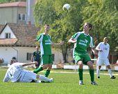 KAPOSVAR, HUNGARY - SEPTEMBER 5: Arpad Horvath (white 17) in action at the Hungarian National Championship under 19 game Kaposvar (white) vs. Nagyatad (green) September 5, 2011 in Kaposvar, Hungary.