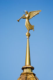 image of angel-trumpet  - Gilded weather vane in the form of an angel blowing on the steeple at the entry of a Orthodox church - JPG