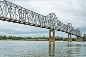 cantilever Cairo Ohio River Bridge in fall scenery with river barges in backgroiund, it provides riv poster