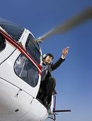 Asian businessman in helicopter