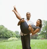 African American man carrying girlfriend
