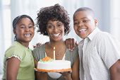 African American mother and children with birthday cake