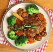 Lamb shank with broccoli dinner