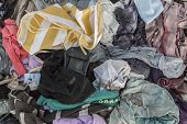 Old Clothes Background, Cenital Plane Of Piles Of Old Clothes Discarded On The Ground poster
