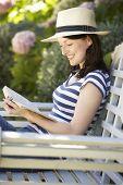 Woman reading in garden