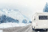 Caravan Or Campervan Turning From Road With Beautiful Mountain Alpine Landscape On Background At Col poster