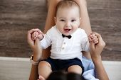 Mother And Child On A White Bed.mom And Baby Boy In Shorts Playing In Sunny Bedroom. Parent And Litt poster