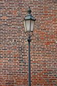 historic lantern with red brick wall