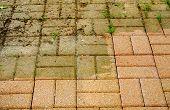 stock photo of dingy  - Grimy and clean sections of patio showing amazing results of power washing - JPG