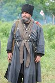 KIEV, UKRAINE -MAY 13: Member of Red Star history club wears historical uniform cossack of Corps von Panvits (German) during historical reenactment of WWII, May 13, 2012 in Kiev, Ukraine