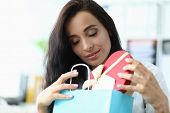 Portrait Of Pretty Female Looking At Bags With Interest And Holding Multicolored Shop Packets With P poster