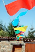party flags of various color in the wind